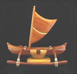 outrigger canoe with sail photo
